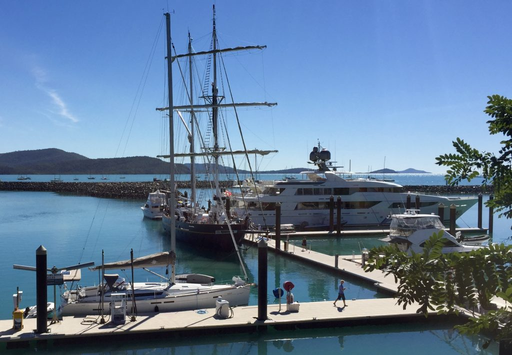 Esprit re-fuelling with the Young Endeavour  training ship, dwarfed by the Mickey Mouse ears stink boat.