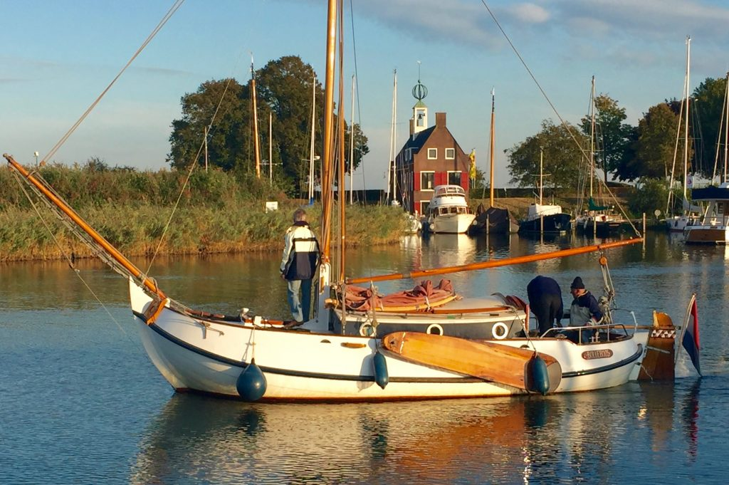 A traditional sailing boat coming in to tie up.