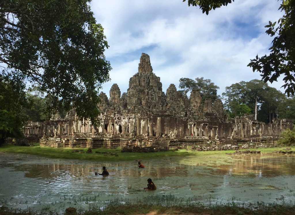 Kids catching snails in the moat around Bayon.